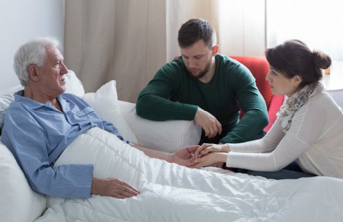 Photo of Elderly Man in Hospital Bed