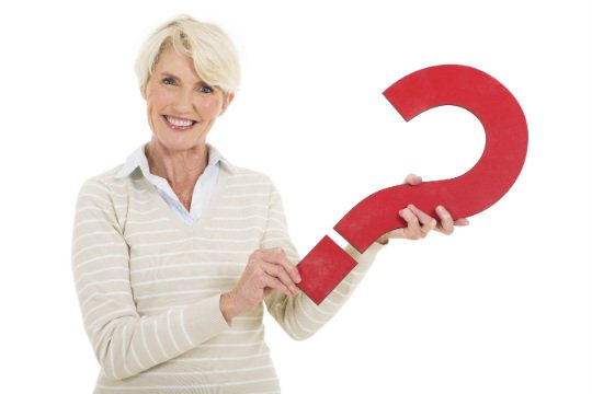Photo of Older Woman Holding a Red Question Mark